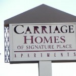 Carriage Homes of Signature Place Apartment Community Sign